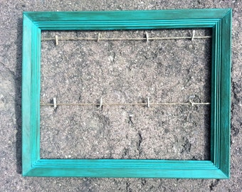 Teal clothesline picture frame with natural twine medium
