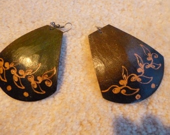 Earrings made of coconut.  Hand etched made in Guatemala.