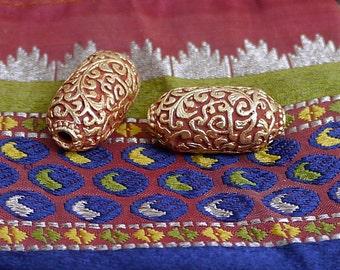 Two Handcarved Tibetan Beads