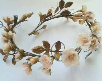 Wreath in a vintage style with flowers of wild roses for dolls