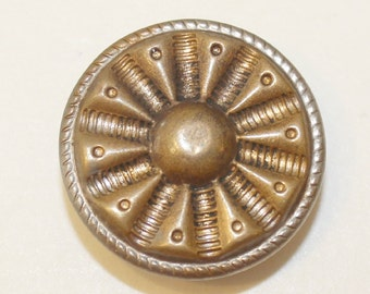 Vintage gold metal button with sun design