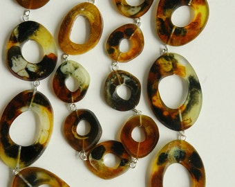 Long Fake Horn necklace made from handmade resin beads