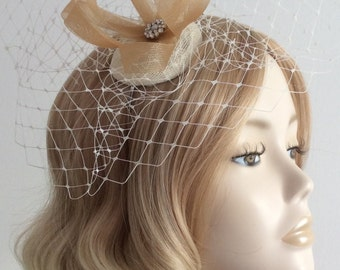 CHAMPAYNE GOLD  and IVORY Fascinator, made with sinamay,crin, net, and crystal detail, on a headband