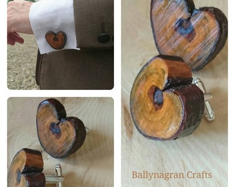 Heart shaped log slice cufflinks.