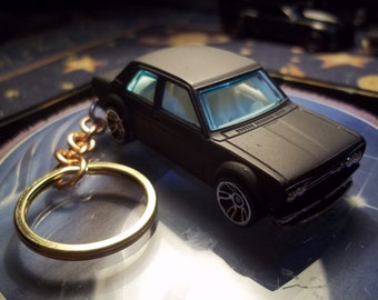 custom made keychain,1969 datsun bluebird 510 coupe,flat black w/chrome mags/repainted-mint