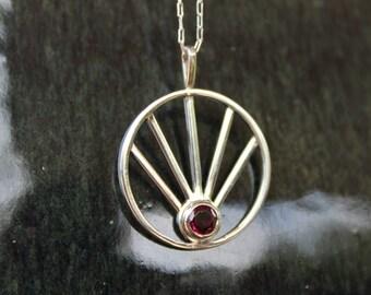 Sterling silver and garnet sunrise pendant