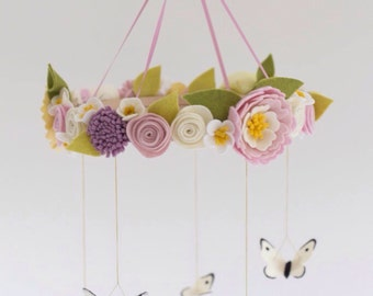 Butterflies and spring flowers baby mobile in muted pastels; dusty pink, lavender and palest yellow. Vintage style.