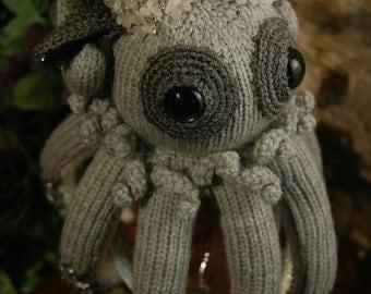 Grey  octopus. Knitted octopus. Art doll.