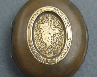 Gutta Percha with gold locket