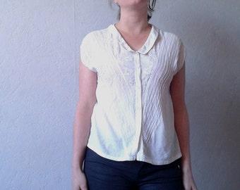 White embroidered sleeveless blouse