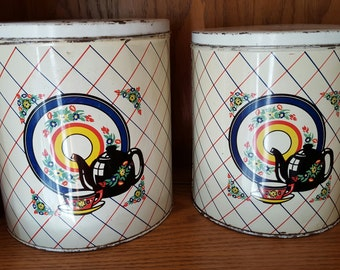 2 enamelware canisters from 1950's Nesting Tins.