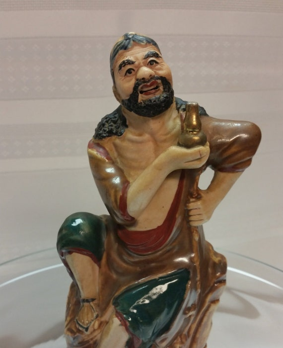 From List Of Names In Colo A Mini Portrait Of Lives: RARE VINTAGE MUDMAN Chinese Male Figurine With Gold Bottle