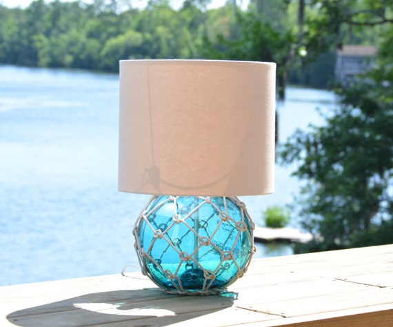 aqua blue glass fishing float lamp with tan linen lamp shade. Black Bedroom Furniture Sets. Home Design Ideas