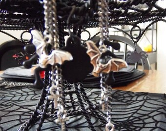 Bat and ankh earrings