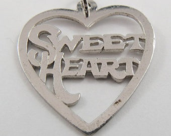 A Sterling Silver Charm for your Sweetheart with a heart around it.
