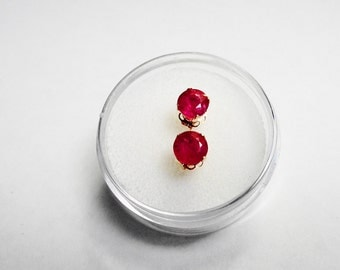 Ruby posts 14kt.. Quality 5mm. Natural  Ruby 14kt. Gold Stud Earrings 1.35 carats in total gem weight.
