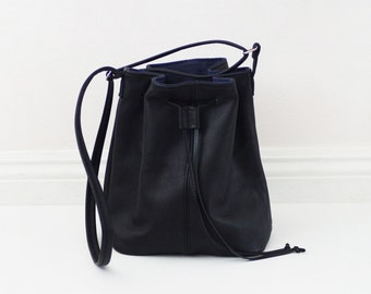 Small black soft leather bucket bag with adjuster