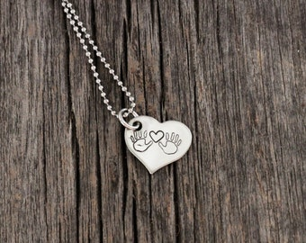 Heart pendant necklace, hand stamped with hands and heart