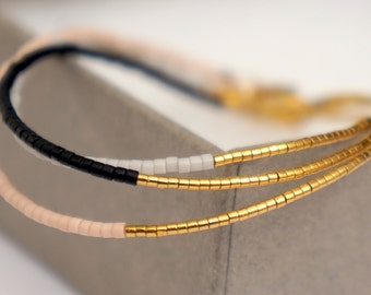 Delicate Miyuki beaded bracelet // Dainty bracelet with 24 carat gold plated beads - Gold plated lobster clasp