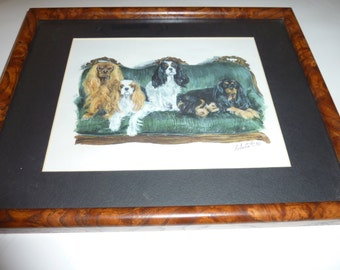 Cavalier King Charles Spaniels in All Four Colors On Velvet Couch by Roberta C mounted in Burl frame