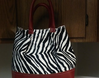 Zebra print purse with red trime