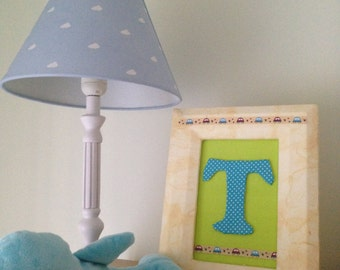 Baby monogram frame in yellow, polka dot blue, and green to decorate the kids room