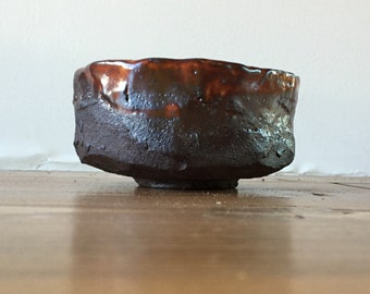 Tea bowl, chawan, dark brown stoneware bowl with Shino glaze