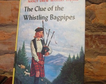 Nancy Drew Mystery Series Book • The Clue of the Whistling Bagpipes #41 • 1960s Publication • Matte Pictorial Hardback Cover