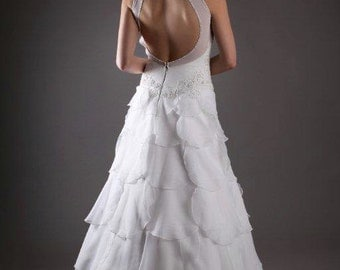 Open back wedding gown with soft ruffles