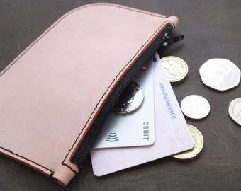 Peach leather coin purse with black stitching and zip. Pastel coloured leather coin purse. Peach leather money pouch. Pastel leather purse