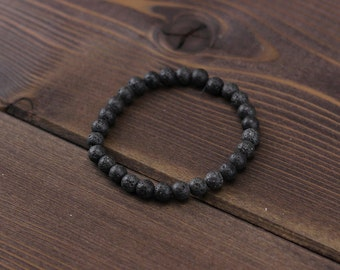 Minimalist black lava bracelet. Matte Black Bracelet Beaded Gemstone Stretch Bracelet. Gift for him Mens accessories Mens jewelry