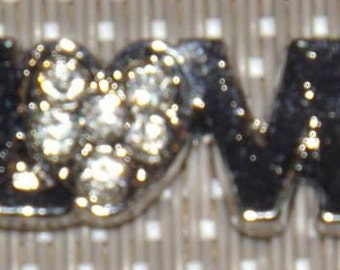 Pendant or charm of metal with small stones (LOVE) 25x10mm