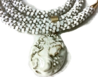 Antique Style Ceramic Cameo Pendant On A Kumihimo Necklace