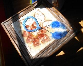 Blue bead, blue spotted feathers adjustable bracelet on black cord.