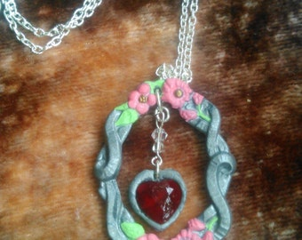 Silver polymer clay framed heart necklace with pink flowers