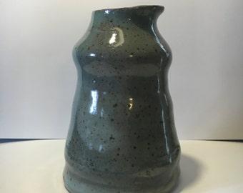 asymmetrical organic ceramic vase.
