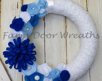 "12"" Yarn wrapped wreath with blue and white felt flowers and decorative buttons"