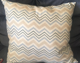 Tan and blue chevron pillow