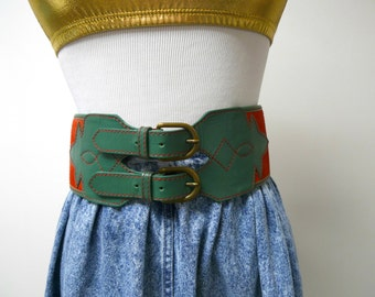 "Mondi . red and green faux leather . double buckle belt . 33"" to 35"""