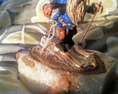 Gnome or Elf Figurine Skiing on Granite Crystal Rock