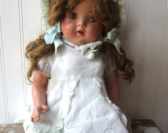 Vintage composition doll cloth and compo mama doll pretty girl doll with dress and bonnet