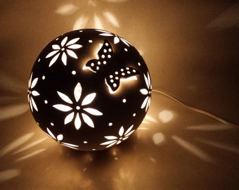 Off-white electric sphere-lamp or candle holder with butterfly and flowers