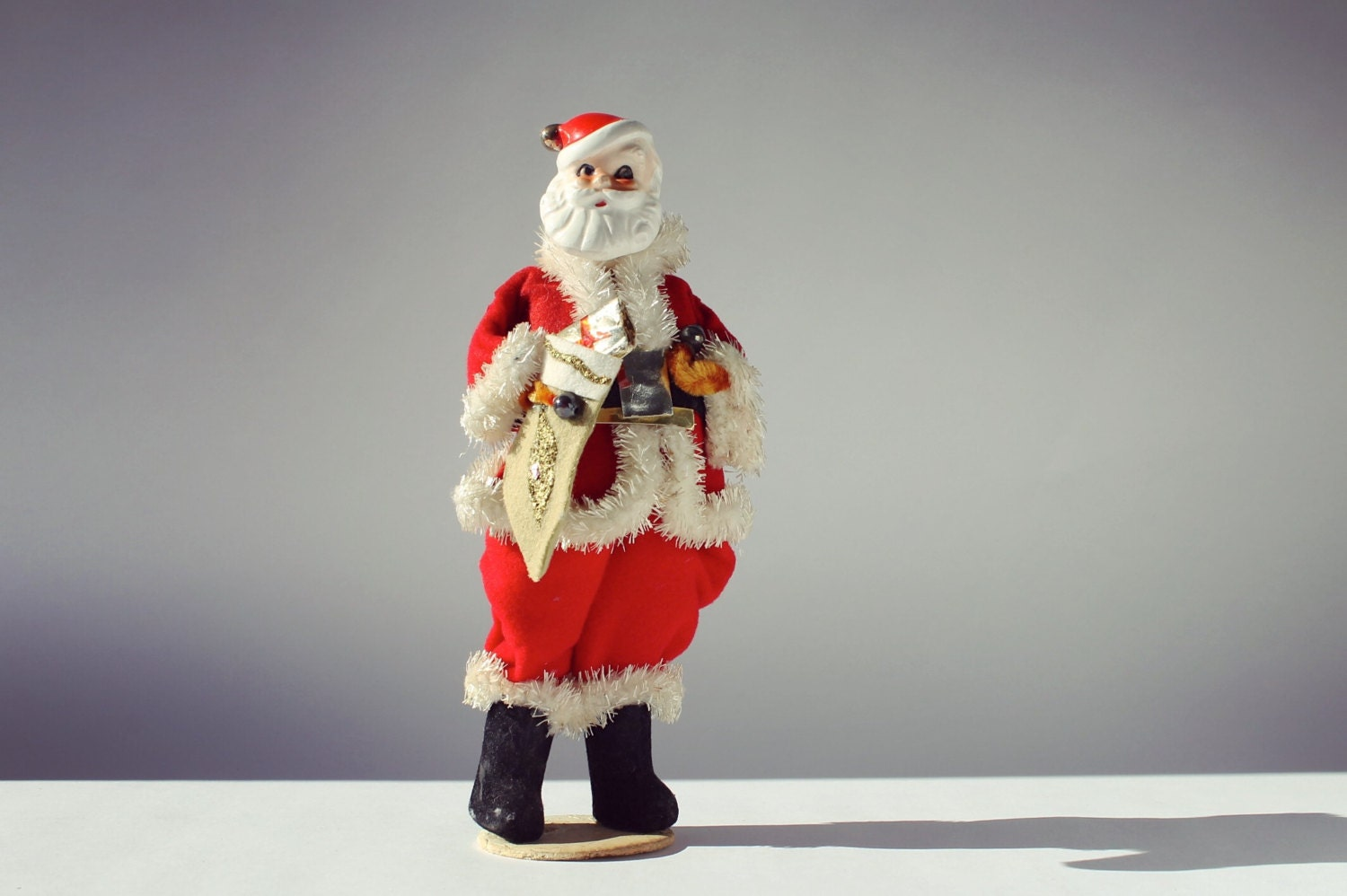 Antique santa claus figurine tall and skinny porcelain