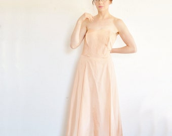 1950 peach strapless Peggy Hunt dress . back to the future mom for sure .medium.large