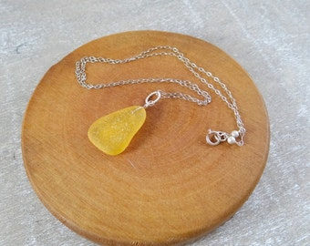 Bright yellow sea glass necklace on a sterling silver chain