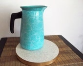 Mid Century Blue Swirly Enamelware Pitcher and Atomic Style Formica Trivet