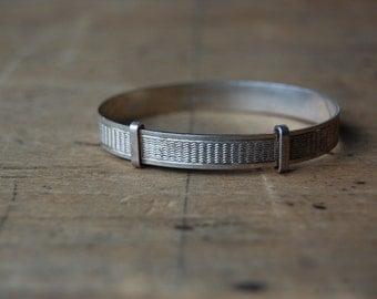 Vintage 1970s English sterling silver baby bracelet