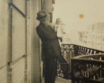 Vintage French Photograph - Man with a Baby on a Balcony