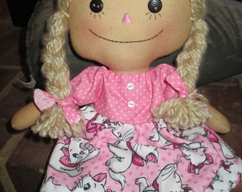 Raggedy loves cat in her pink dress