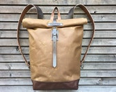 Waxed canvas rucksack / backpack with roll up top and leather shoulderstraps,handle and leather bottem COLLECTION UNISEX
